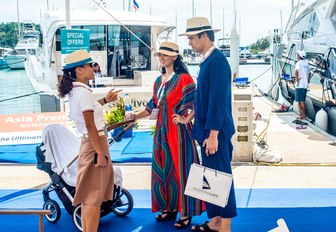 visitors stop on the boardwalks of the Thailand Yacht Show to speak to an exhibitor