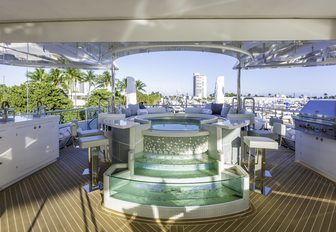custom-made Jacuzzi with waterfall feature and swim-up bar on board charter yacht 'King Baby'