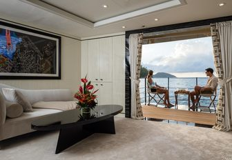 charter guests unwind on the balcony of the VIP suite aboard motor yacht LILI