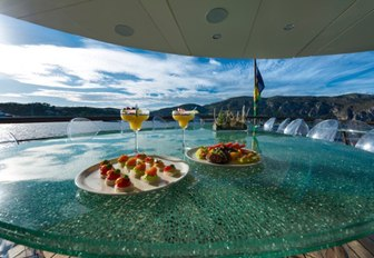 Selection of canapes and refreshments on table of Superyacht CHAKRA
