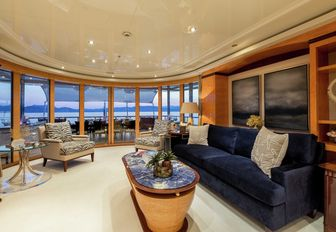 navy blue sofa and armchairs in an upper deck salon aboard charter yacht Lucky Lady