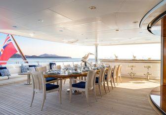rectangular alfresco dining option aboard motor yacht TITANIA