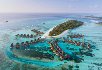 bungalows in the maldives, with little island