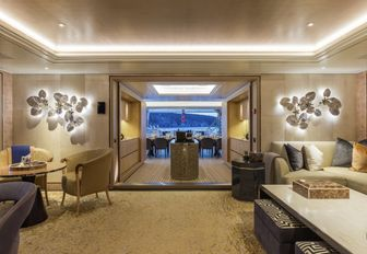 upper deck salon with views onto the terrace aboard luxury yacht JOY