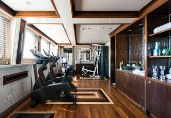 The treadmills lining the gym section of superyacht LEGEND