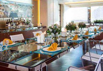 formal dining area in the main salon of superyacht AQUIJO