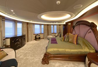 master suite with Belle Epoque styling and panoramic views on board charter yacht AMARYLLIS