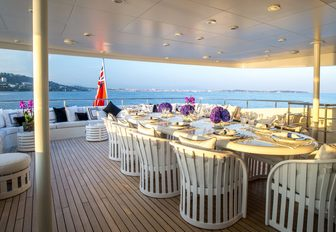 stylish alfresco dining setup on upper deck aft of superyacht MISCHIEF