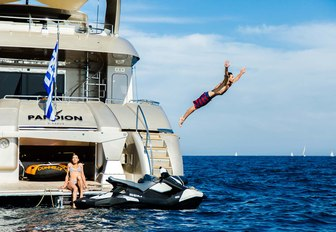 charter guest jumps off yacht into blue water