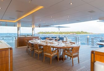 alfresco dining area on the upper deck aft of superyacht WHEELS