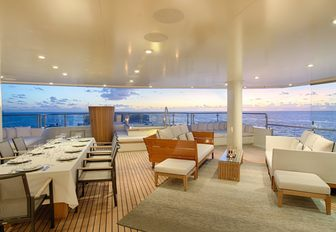 alfresco dining and lounge area on board charter yacht SENSES