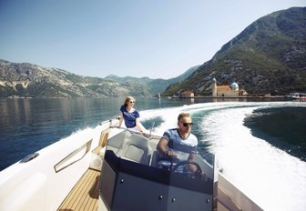 charter guests take out the tender on the clear, calm waters of Montenegro