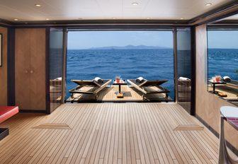 drop-down balcony with teak sun loungers on board charter yacht Alfa Nero
