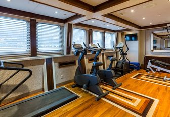 A collection of exercise equipment inside a superyacht gymnasium