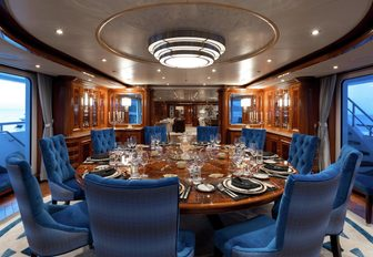 circular dining table on the bridge deck aft of charter yacht TITANIA