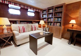 Office area on luxury yacht ELEMENT with bookcases and coffee table