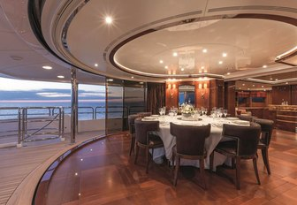 Semi al fresco dining on superyacht CHECKMATE