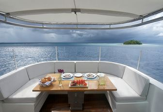 casual open-air dining area suitable for breakfast on board luxury yacht SENSES