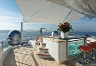 The Jacuzzi situated on the exterior of luxury yacht Excellence V