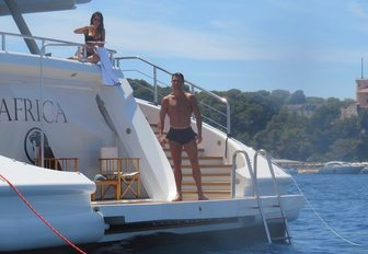 Cristiano Ronaldo stands on swim platform of charter yacht next to girlfriend Georgina Rodriguez