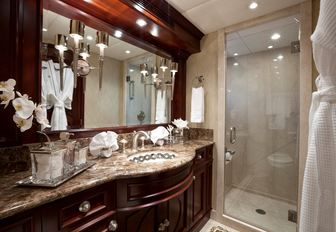master's en suite on luxury yacht alessandra, with marble surfaces and elegant details