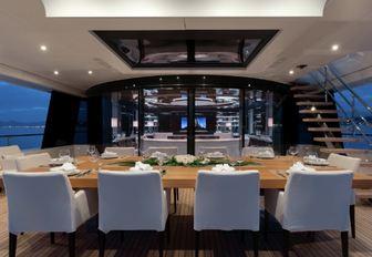 alfresco dining setup on the upper deck aft of charter yacht MYSKY