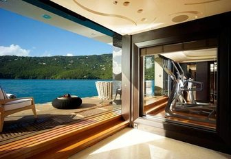 The dedicated gymnasium and retractable balcony featured on superyacht KISMET