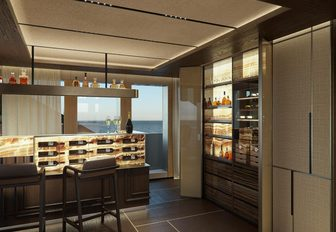 illuminating bar with bright window behind it inside the main salon of charter yacht geco