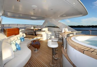 Jacuzzi, swim up bar and seating area on the sundeck of luxury yacht SOLIS