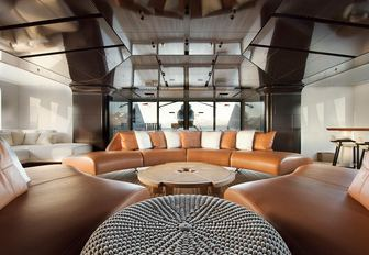 the curvaceous and stylish interior of charter yacht cloud breaker provides the perfect spot for friends and family to unwind while they are on their self isolation luxury yacht charter vacation