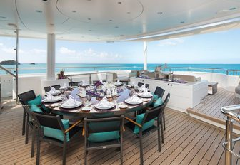 alfresco dining setup on the upper deck aft of luxury yacht SIREN