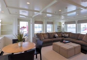light and airy upper salon aboard charter yacht SAFIRA with large, L-shaped sofa