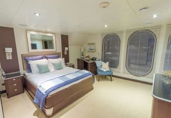 master suite with huge port hole windows on board charter yacht GLOBAL