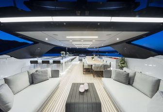 White furnishings line the sundeck of a superyacht