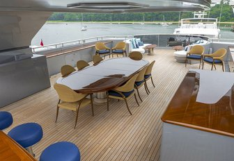 luxury yacht sundeck with dining and bar
