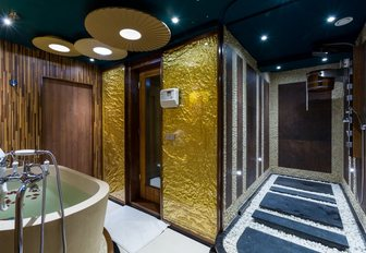 The Jacuzzi bath and gold deco of the spa on board superyacht LEGEND