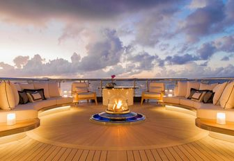 The fire pit included on the sun deck of luxury yacht KISMET