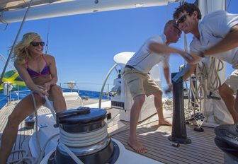 charter guest joins in with the crew on deck aboard superyacht JUPITER