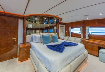 the luxurious master cabin inside charter yacht quintessa withking sized bed, private en suite facilities, and lounging area