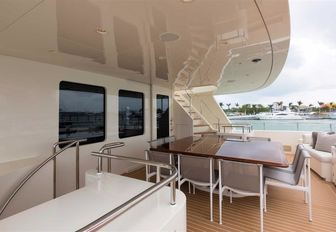alfresco dining around square table on the upper deck aft of superyacht SAFIRA