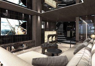 sofa and huge TV screen on board motor yacht SOLO