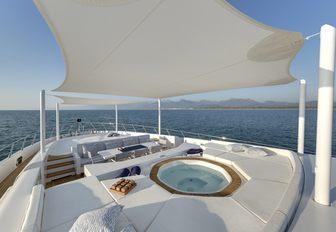 A Jacuzzi beneath bimini shading on board the superyacht of luxury yacht Da Vinci