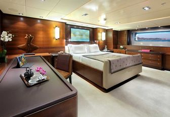 owners suite on sailing yacht prana, with bed in middle and spacious dressing table