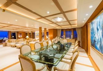 formal dining area with glass-topped table aboard luxury yacht CALLISTO