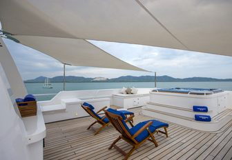 Bimini-covered sundeck with chaise loungers and Jacuzzi aboard expedition yacht 'Northern Sun'