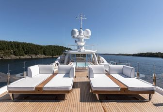 chic oversized sun-loungers on the sundeck of charter yacht LILI