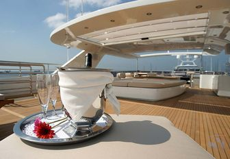 champagne is served on the sundeck of charter yacht TATIANA