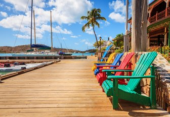 Adirondack chairs on a dock on Virgin Gorda Island, BVI