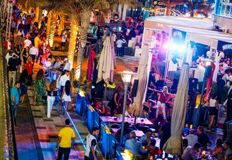 busy streets with open-air bars and restaurants in Abu Dhabi