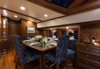 Indoor dining on board sailing yacht MARAE